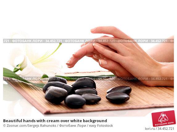 Beautiful hands with cream over white background. Стоковое фото, фотограф Zoonar.com/Sergejs Rahunoks / easy Fotostock / Фотобанк Лори
