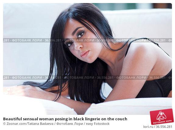 Beautiful sensual woman posing in black lingerie on the couch. Стоковое фото, фотограф Zoonar.com/Tatiana Badaeva / easy Fotostock / Фотобанк Лори