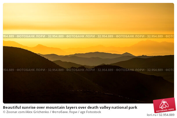 Beautiful sunrise over mountain layers over death valley national park. Стоковое фото, фотограф Zoonar.com/Alex Grichenko / age Fotostock / Фотобанк Лори