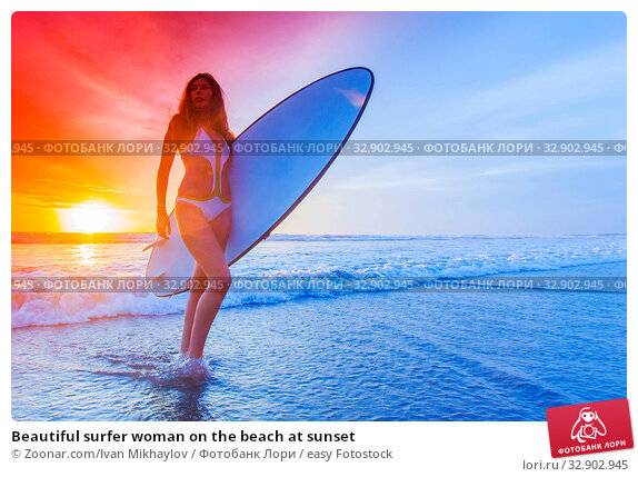 Beautiful surfer woman on the beach at sunset. Стоковое фото, фотограф Zoonar.com/Ivan Mikhaylov / easy Fotostock / Фотобанк Лори