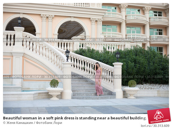 Купить «Beautiful woman in a soft pink dress is standing near a beautiful building.», фото № 30313609, снято 19 января 2019 г. (c) Женя Канашкин / Фотобанк Лори