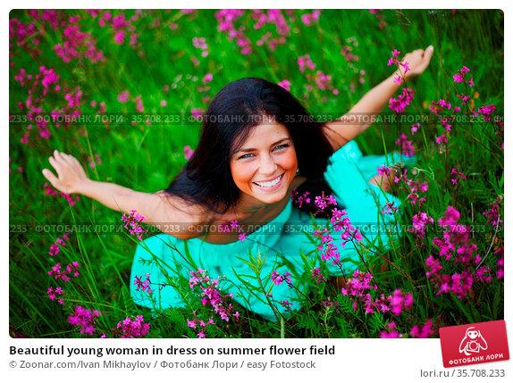 Beautiful young woman in dress on summer flower field. Стоковое фото, фотограф Zoonar.com/Ivan Mikhaylov / easy Fotostock / Фотобанк Лори