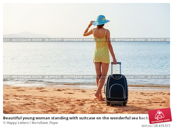 Купить «Beautiful young woman standing with suitcase on the wonderful sea background, concept of time to travel», фото № 28419517, снято 19 апреля 2018 г. (c) Happy Letters / Фотобанк Лори