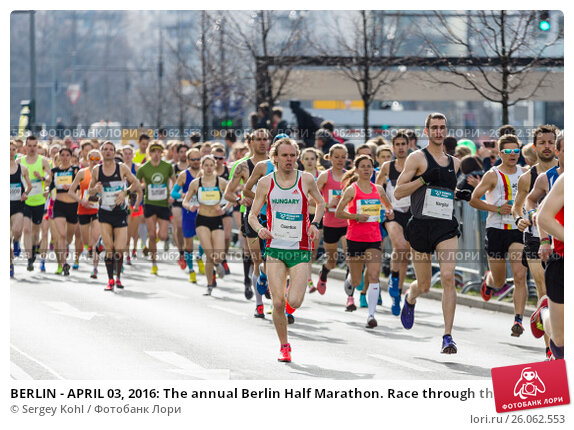 Купить «BERLIN - APRIL 03, 2016: The annual Berlin Half Marathon. Race through the city streets.», фото № 26062553, снято 3 апреля 2016 г. (c) Sergey Kohl / Фотобанк Лори