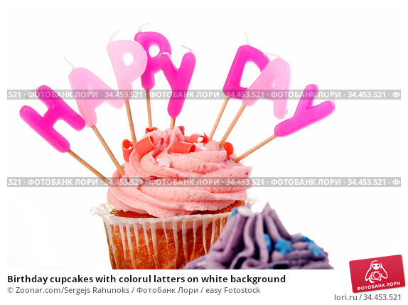 Birthday cupcakes with colorul latters on white background. Стоковое фото, фотограф Zoonar.com/Sergejs Rahunoks / easy Fotostock / Фотобанк Лори