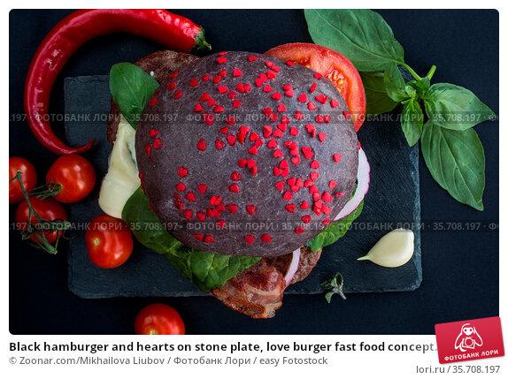 Black hamburger and hearts on stone plate, love burger fast food concept... Стоковое фото, фотограф Zoonar.com/Mikhailova Liubov / easy Fotostock / Фотобанк Лори