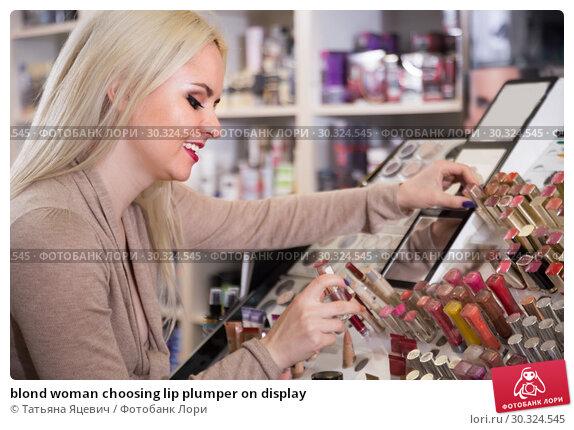 Купить «blond woman choosing lip plumper on display», фото № 30324545, снято 29 февраля 2016 г. (c) Татьяна Яцевич / Фотобанк Лори