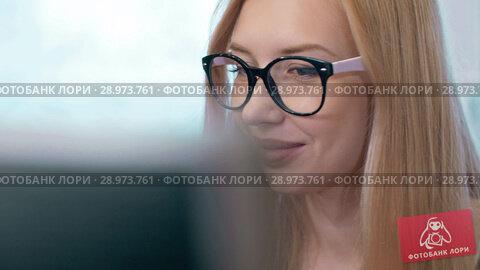 Купить «Blonde Woman Working on Computer», видеоролик № 28973761, снято 8 августа 2018 г. (c) Илья Шаматура / Фотобанк Лори