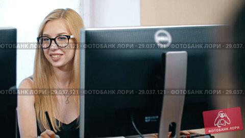 Купить «Blonde Woman Working on Computer», видеоролик № 29037121, снято 8 августа 2018 г. (c) Илья Шаматура / Фотобанк Лори