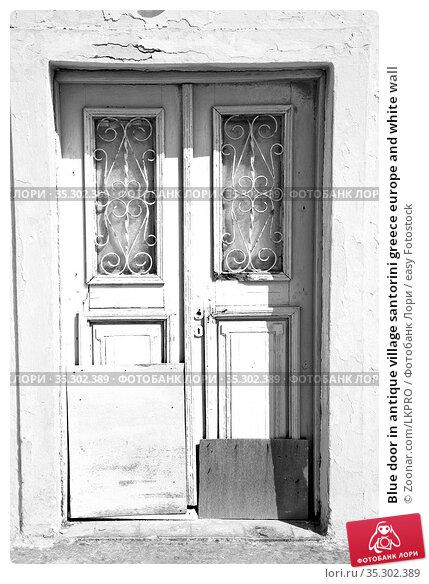 Blue door in antique village santorini greece europe and white wall. Стоковое фото, фотограф Zoonar.com/LKPRO / easy Fotostock / Фотобанк Лори