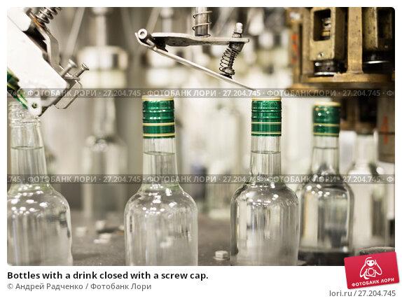 Купить «Bottles with a drink closed with a screw cap.», фото № 27204745, снято 5 июля 2017 г. (c) Андрей Радченко / Фотобанк Лори