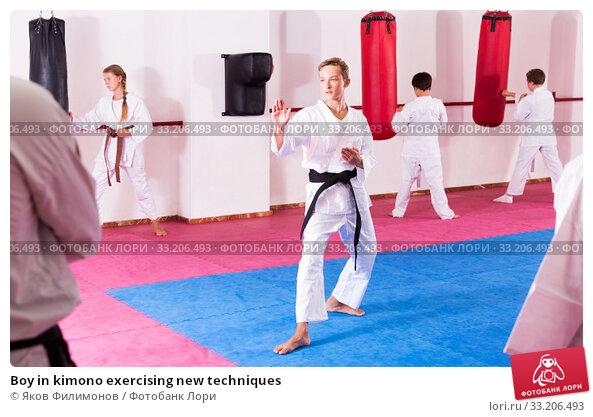 Купить «Boy in kimono exercising new techniques», фото № 33206493, снято 10 июля 2020 г. (c) Яков Филимонов / Фотобанк Лори