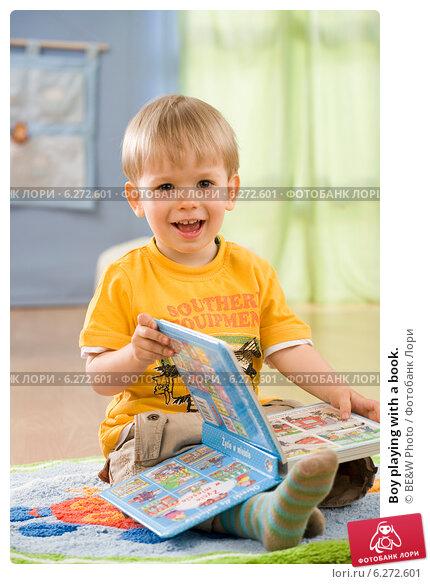 Купить «Boy playing with a book.», фото № 6272601, снято 23 июля 2019 г. (c) BE&W Photo / Фотобанк Лори