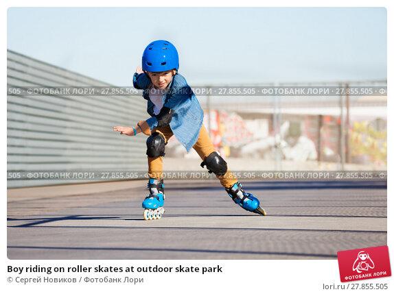 Купить «Boy riding on roller skates at outdoor skate park», фото № 27855505, снято 14 октября 2017 г. (c) Сергей Новиков / Фотобанк Лори