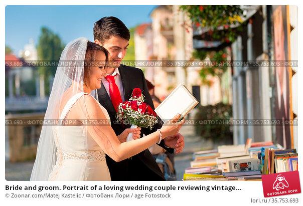 Bride and groom. Portrait of a loving wedding couple reviewing vintage... Стоковое фото, фотограф Zoonar.com/Matej Kastelic / age Fotostock / Фотобанк Лори