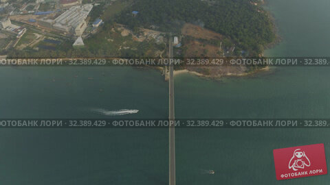 Купить «Bridge over the sea, asphalt road blue water Drone shot in Cambodia», видеоролик № 32389429, снято 26 октября 2019 г. (c) Aleksejs Bergmanis / Фотобанк Лори