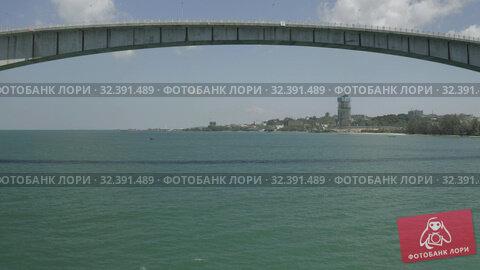 Купить «Bridge over the sea, asphalt road blue water Drone shot in Cambodia», видеоролик № 32391489, снято 26 октября 2019 г. (c) Aleksejs Bergmanis / Фотобанк Лори