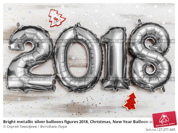 Купить «Bright metallic silver balloons figures 2018, Christmas, New Year Balloon with glitter stars on white wood table background», фото № 27271665, снято 19 ноября 2017 г. (c) Сергей Тимофеев / Фотобанк Лори