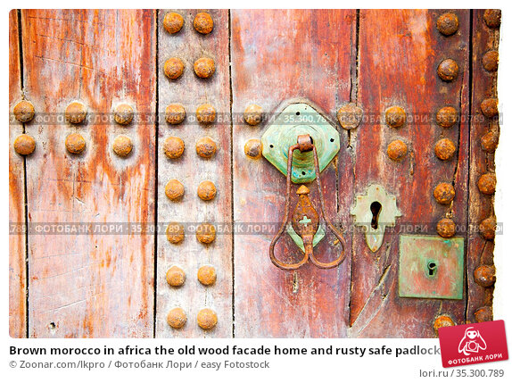 Brown morocco in africa the old wood facade home and rusty safe padlock... Стоковое фото, фотограф Zoonar.com/lkpro / easy Fotostock / Фотобанк Лори