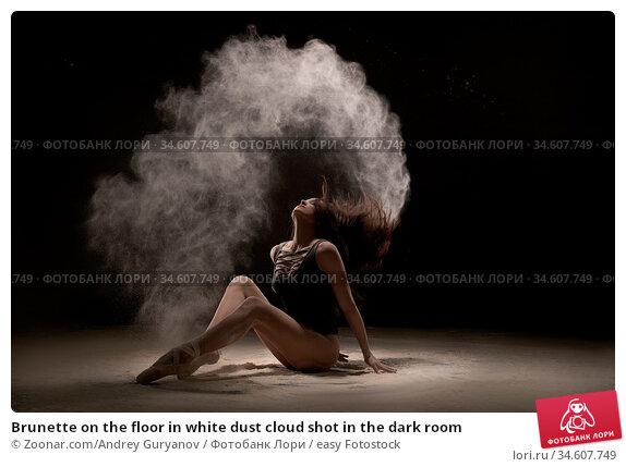 Brunette on the floor in white dust cloud shot in the dark room. Стоковое фото, фотограф Zoonar.com/Andrey Guryanov / easy Fotostock / Фотобанк Лори