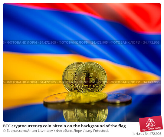 BTC cryptocurrency coin bitcoin on the background of the flag. Стоковое фото, фотограф Zoonar.com/Anton Litvintsev / easy Fotostock / Фотобанк Лори