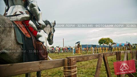 BULGAR, RUSSIA 11-08-2019: Knights battle on the green field - a man waiting for his turn astride a horse. Редакционное видео, видеограф Константин Шишкин / Фотобанк Лори
