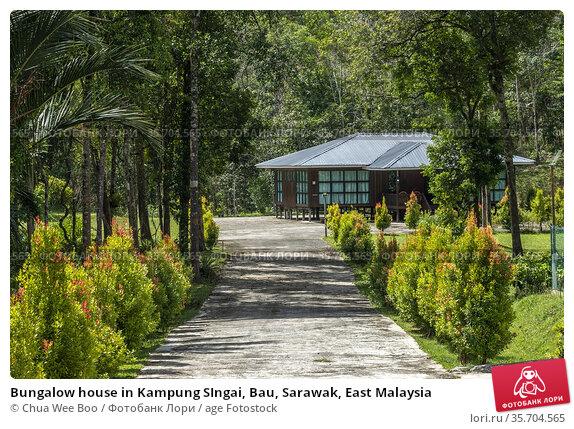 Bungalow house in Kampung SIngai, Bau, Sarawak, East Malaysia. Стоковое фото, фотограф Chua Wee Boo / age Fotostock / Фотобанк Лори