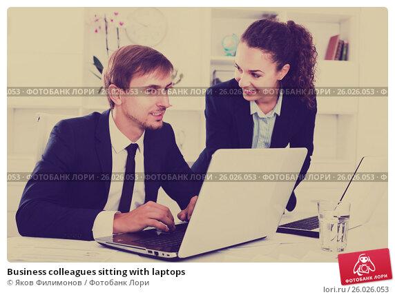 Business colleagues sitting with laptops, фото № 26026053, снято 17 августа 2017 г. (c) Яков Филимонов / Фотобанк Лори