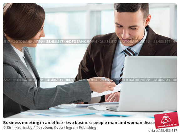 Купить «Business meeting in an office - two business people man and woman discussing their plans and reports», фото № 28486517, снято 2 февраля 2013 г. (c) Ingram Publishing / Фотобанк Лори