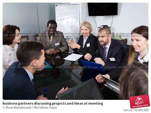 business partners discussing projects and ideas at meeting. Стоковое фото, фотограф Яков Филимонов / Фотобанк Лори