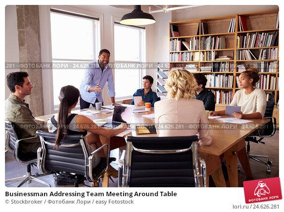 Купить «Businessman Addressing Team Meeting Around Table», фото № 24626281, снято 6 ноября 2015 г. (c) easy Fotostock / Фотобанк Лори