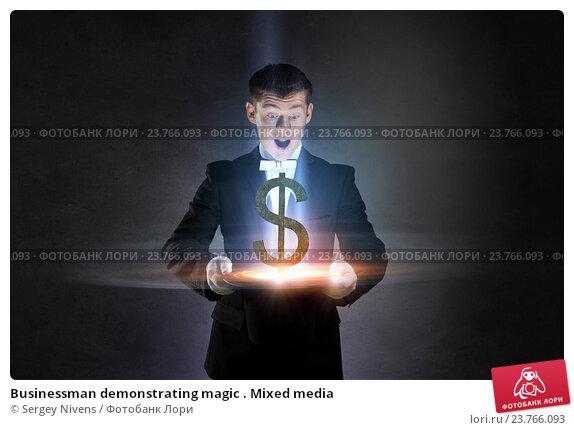 Купить «Businessman demonstrating magic . Mixed media», фото № 23766093, снято 4 октября 2014 г. (c) Sergey Nivens / Фотобанк Лори
