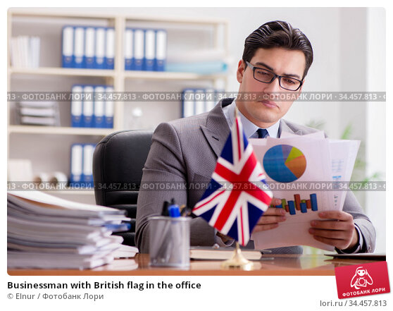 Businessman with British flag in the office. Стоковое фото, фотограф Elnur / Фотобанк Лори