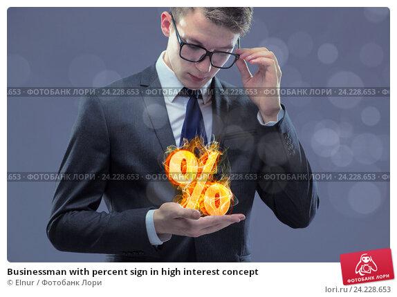Купить «Businessman with percent sign in high interest concept», фото № 24228653, снято 8 июля 2016 г. (c) Elnur / Фотобанк Лори