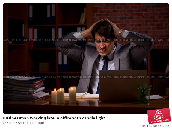Businessman working late in office with candle light. Стоковое фото, фотограф Elnur / Фотобанк Лори