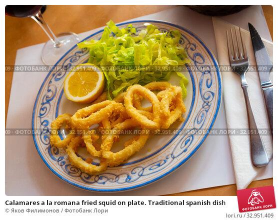 Купить «Calamares a la romana fried squid on plate. Traditional spanish dish», фото № 32951409, снято 30 марта 2020 г. (c) Яков Филимонов / Фотобанк Лори