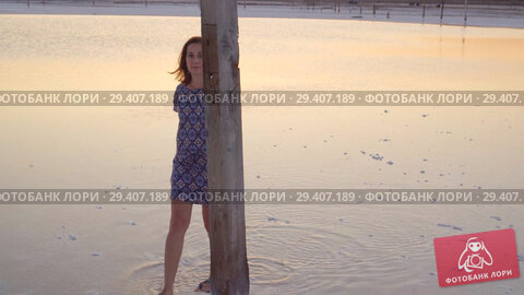 Купить «Calm girl enjoying sun, walking slowly through the water of a salt lake», видеоролик № 29407189, снято 3 ноября 2018 г. (c) Ирина Мойсеева / Фотобанк Лори
