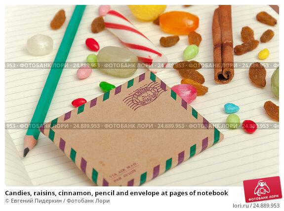 Candies, raisins, cinnamon, pencil and envelope at pages of notebook. Стоковое фото, фотограф Евгений Пидеркин / Фотобанк Лори