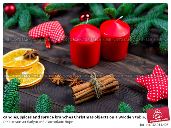 candles, spices and spruce branches Christmas objects on a wooden table, closeup. Стоковое фото, фотограф Константин Лабунский / Фотобанк Лори