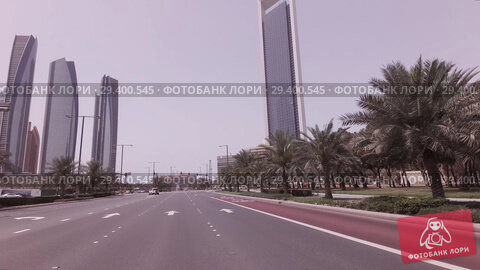 Купить «Car trip near the skyscrapers Etihad Towers in Abu Dhabi stock footage video», видеоролик № 29400545, снято 4 апреля 2018 г. (c) Юлия Машкова / Фотобанк Лори