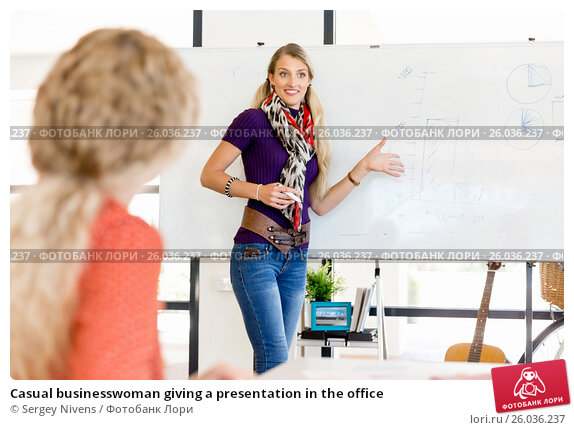 Casual businesswoman giving a presentation in the office, фото № 26036237, снято 14 декабря 2014 г. (c) Sergey Nivens / Фотобанк Лори
