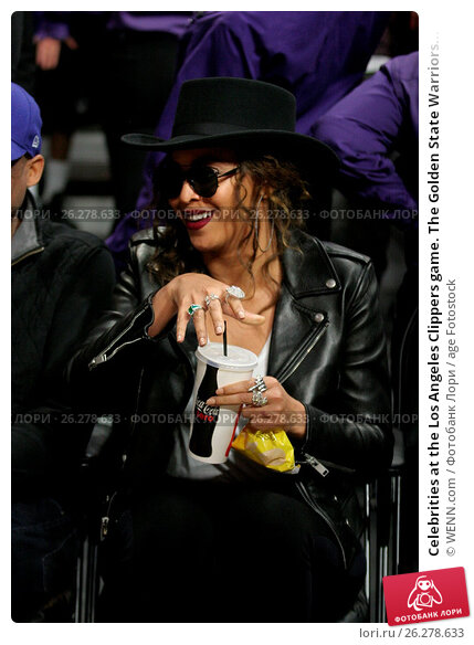 Купить «Celebrities at the Los Angeles Clippers game. The Golden State Warriors defeated the Los Angeles Clippers by the final score of 115-112 at Staples Center...», фото № 26278633, снято 20 февраля 2016 г. (c) age Fotostock / Фотобанк Лори