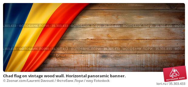 Chad flag on vintage wood wall. Horizontal panoramic banner. Стоковое фото, фотограф Zoonar.com/Laurent Davoust / easy Fotostock / Фотобанк Лори