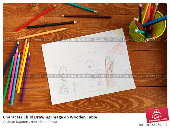 Купить «Character Child Drawing Image on Wooden Table», фото № 32230117, снято 25 марта 2019 г. (c) Иван Карпов / Фотобанк Лори