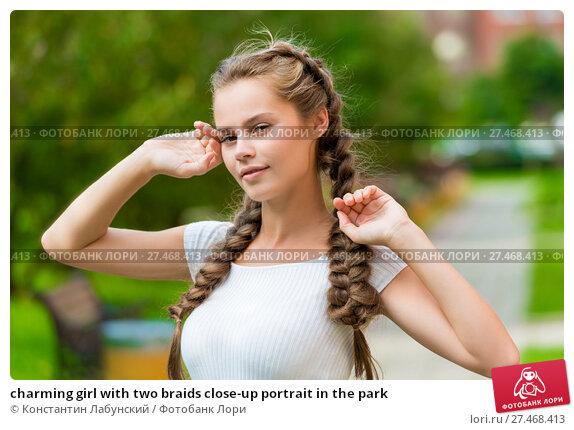 Купить «charming girl with two braids close-up portrait in the park», фото № 27468413, снято 13 сентября 2017 г. (c) Константин Лабунский / Фотобанк Лори