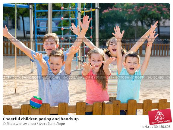 Cheerful children posing and hands up. Стоковое фото, фотограф Яков Филимонов / Фотобанк Лори