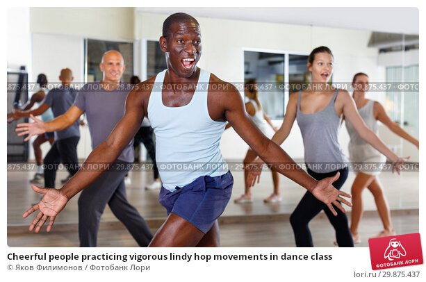 Купить «Cheerful people practicing vigorous lindy hop movements in dance class», фото № 29875437, снято 30 июля 2018 г. (c) Яков Филимонов / Фотобанк Лори