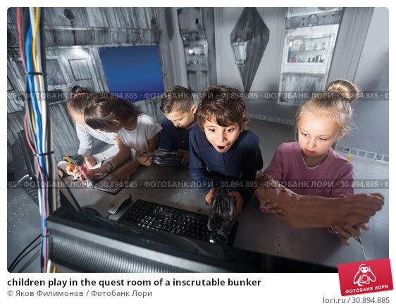Купить «children play in the quest room of a inscrutable bunker», фото № 30894885, снято 21 октября 2017 г. (c) Яков Филимонов / Фотобанк Лори