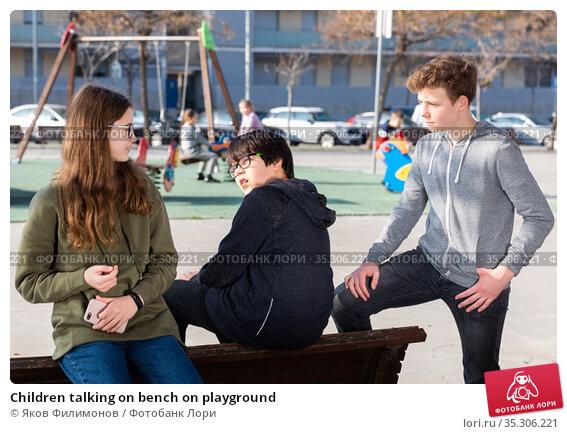Children talking on bench on playground. Стоковое фото, фотограф Яков Филимонов / Фотобанк Лори