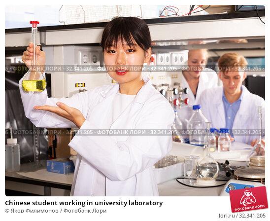 Купить «Chinese student working in university laboratory», фото № 32341205, снято 28 мая 2019 г. (c) Яков Филимонов / Фотобанк Лори